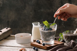 Chia pudding with berries and milk, sweet nourishing dessert, healthy breakfast superfood concept - 248793297
