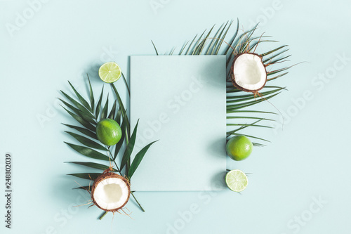 Summer composition. Tropical palm leaves, fruits, paper blank on pastel blue background. Summer concept. Flat lay, top view, copy space - 248802039
