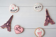 Gingerbread on the subject of France on white table. Heart, eiffel tower, paris. Love theme, valentine. Top view.