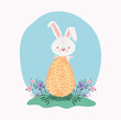 cute rabbit with egg painted and flowers in the garden