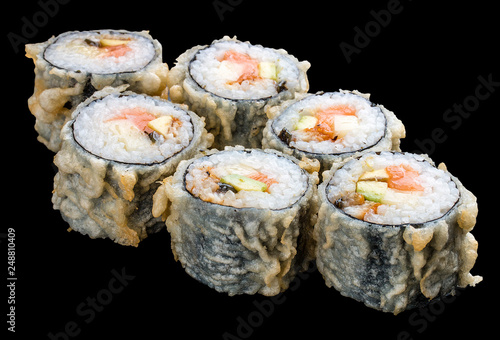 Roll tempura with salmon and vegetables on black background