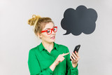Business woman looking at phone, thinking bubble - 248813277