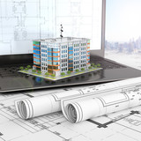 layout of a residential house on an open laptop with drawing projects. 3d illustration