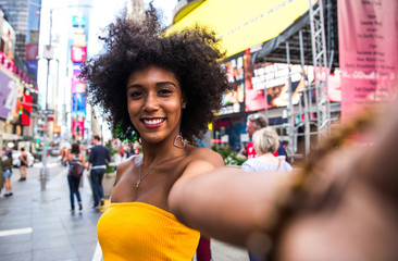 Young beautiful girl walking in Time square, manhattan. Lifestyle concepts about New york