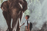 Man and childrens going in the jungle with the elephant, lifestyle moments from northern Thailand
