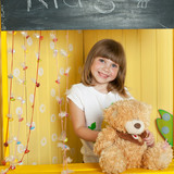 The girl hold bear toy in candy bar in yellow background - 248823686