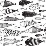 Seamless pattern with hand drawn cute fish in sketch style.