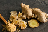 Ginger root, candied and ginger powder in wooden spoon over grey concrete background - 248833274