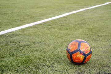 Soccer ball on grass football field