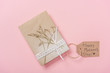 mothers day greeting card decorated with dried plant and lace ribbon, with happy mothers day greeting text on pink background