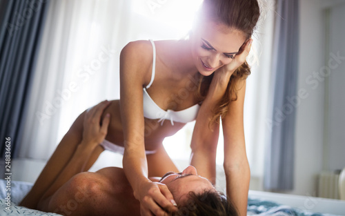 Leinwanddruck Bild Woman and man playing domination games in bed