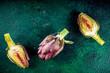 Quadro Fresh artichoke flower. Raw organic artichokes on dark concrete background, copy space