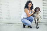 Beautiful woman with a dog  - 248854034
