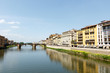 Bridge across the Arno River, Florence, Italy with palazzos lining the bank