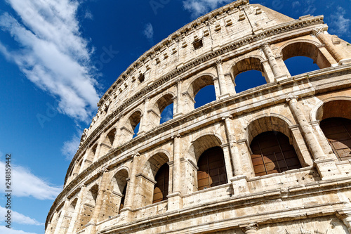Rome/ Italy July 2018: Colosseum in Rome, Italy. Ancient Roman Colosseum is one of the main tourist attractions in Europe. Scenic view of Colosseum ruins in summer.