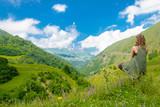 una donna medita nella natura yoga - 248861441