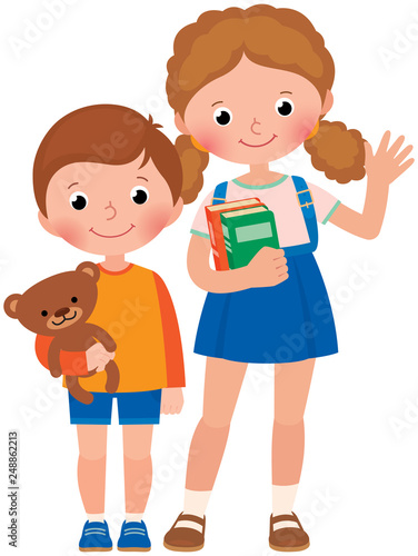Two children, a little boy and a girl, pupils of elementary school or a preschool with a schoolbag, books and a toy