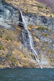 the harsh nature, the mountain river, the rocks and the waterfall flows into the fjord. Norwegian landscape