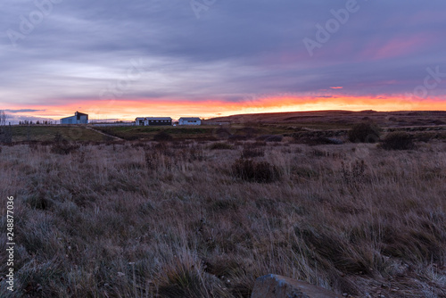 Farmhouse and Barns in the Countryside of Iceland at Sunset