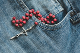 Catholic rosary in the jeans pocket