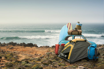 Tourist camp with tent and car on the ocean