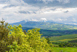 Beautiful landscape view in Tuscany with storm clouds and a mountain - 248890402
