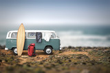 Tourist camp with bags, surfboard and car on the ocean - 248893026