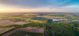 Aerial view of the fresh bright green lush countryside at sunset
