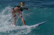 Sports woman surfing wave on surfboard in ocean