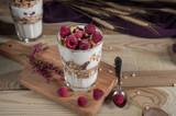 Yogurt parfait with granola and fresh raspberries