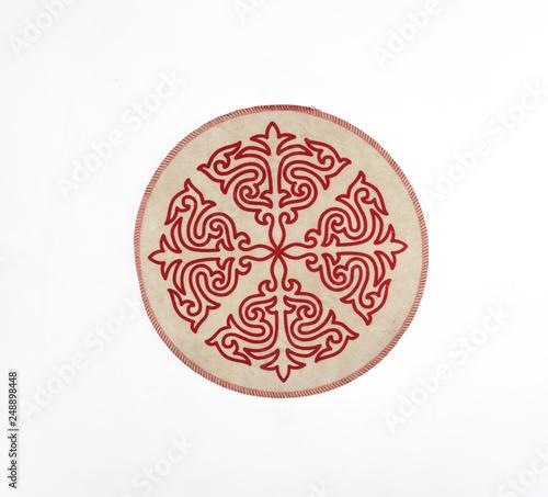 Kazakh national ornament on fabric © serikbaib