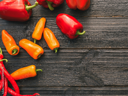 different types of pepper on a wooden table . bell pepper, chili - 248900078