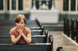 Little boy praying in church - 248918293