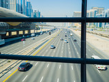 A wide multi-lane road in Dubai. View from the subway crossing.