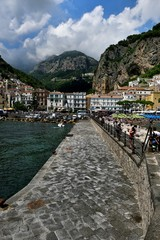 Tourists visiting the harbour of Amalfi © drewrawcliffe