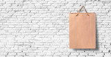white brick wall with paper bag