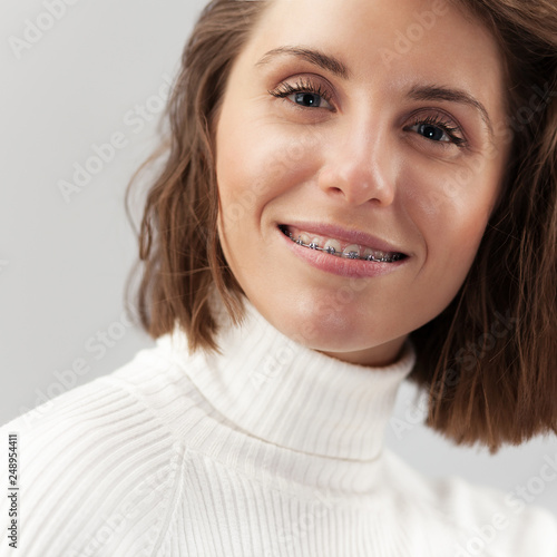 Young beautiful woman with braces