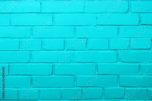 Blue color brick wall background, copy space.