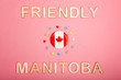 Happy Canada Day greeting card with wooden letters. Manitoba provincial license slogan saying wild rose country and Canadian flag with many hearts on living coral pink background.