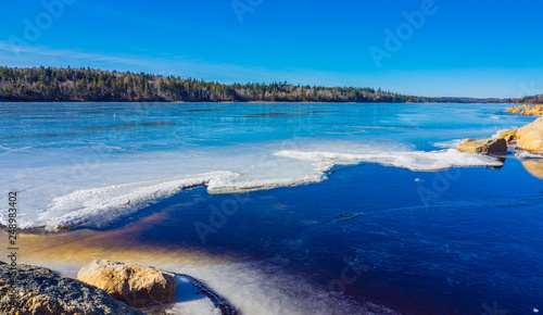 Foto Murales sea and rocks on a sunny day in winter, Canada, ice, cold