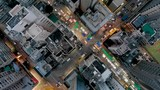 Temple Street Market, Hong Kong, Birds eye view in city centre of Kowloon, Urban landscape view at night footage, Aerial view from the top, Drone China