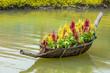 Leinwanddruck Bild - Celosia argentea L. cv. Plumosa flower in The boat is made from bamboo on water
