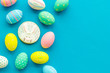 Easter symbols. Colorful Easter eggs and gingerbread on blue background space for text
