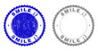 Grunge SMILE ;) stamp seals isolated on a white background. Rosette seals with grunge texture in blue and grey colors. Vector rubber stamp imitation of SMILE ;) tag inside round rosette.