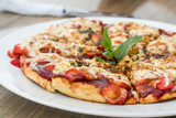 Strawberry pizza on a white plate - 249041472