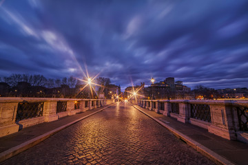 View of the bridge of the Holy Angel in the early morning and the dramatic sky. Rome. Italy. © annavalerievna1