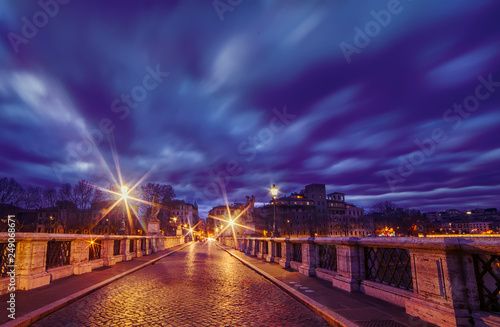 View of the bridge of the Holy Angel in the early morning and the dramatic sky. Rome. Italy.