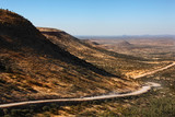Remote desert road through Damaraland in Namibia poster