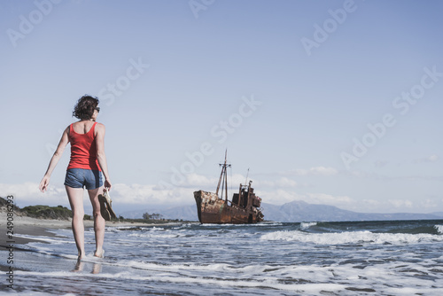 Foto Murales Tourist woman on beach enjoying vacation