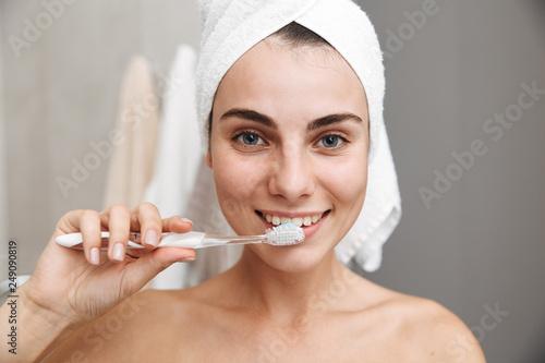 Leinwandbild Motiv Close up of a beautiful young woman with towel